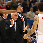 Larry Brown, the SMU coach congratulates Nic Moore, SMU, after victory during the Temple Vs SMU Semi Final game at the American Athletic Conference Men's College Basketball Championships 2015 at the XL Center, Hartford, Connecticut, USA. 14th March 2015. Photo Tim Clayton