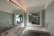 modern bathroom of a house, large window