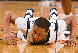 Virginia guard Sylven Landesberg (15) is knocked down to the court.  The Virginia Cavaliers defeated the Virginia Tech Hokies 75-61 at the John Paul Jones Arena on the Grounds of the University of Virginia in Charlottesville, VA on February 18, 2009.
