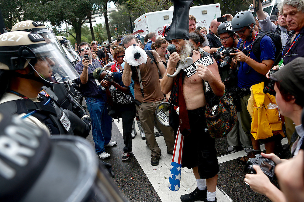 Vermin Supreme, a well-known anarchist and activist, speaks directly to law enforecemeent officers through a megaphone during a protest surrounding the 2012 Republican National Convention on August 27, 2012 in Tampa, Fla.