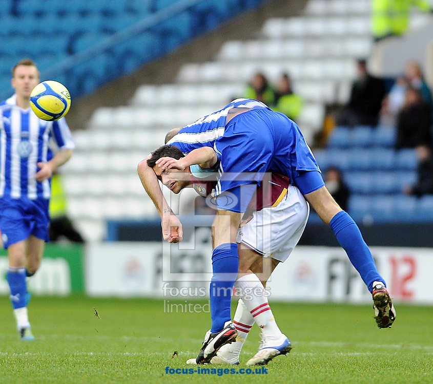 Picture by Graham Crowther/Focus Images Ltd. 07763140036.08/01/12.Rob Jones of Sheffield Wednesday puts the pressure on Sam Baldock of West Ham during the FA Cup third round match at Hillsborough stadium, Sheffield.