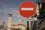 A No Entry sign in Arabic and the minaret of a mosque in the modern city of Luxor, Nile Valley, Egypt.