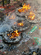 Pharping, Nepal - November 26, 2005: Candles burn on the stone floor of ancient Dakshinkali Hindu temple in Pharping, Nepal.