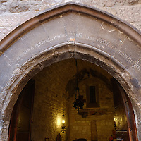 ASSISI, ITALY - OCTOBER 03:  A view  of the door of the house where Saint Francis was born seen on October 3, 2013 in Assisi, Italy. Pope Francis is due to venerate the tomb of San Francesco of Assisi tomorrow during his one-day visit to the city.  (Photo by Marco Secchi/Getty Images)