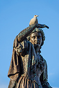 Flora MacDonald (Gaelic: Fionnghal nic Dhòmhnaill; 1722 –1790) was a Scottish Jacobite heroine. She is honored by a bronze statue atInverness Castle(on Castle Hill, also known as Castle Wynd), designed by Andrew Davidson, erected in 1896. Inverness is the administrative capital of the Highlands, in Scotland, United Kingdom, Europe. The live bird atop her head stayed longer than I was able to wait.