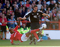 Photo: Leigh Quinnell.<br /> Nottingham Forest v Bristol City. Coca Cola League 1. 21/10/2006. Forests Junior Agogo gets to the ball ahead of Bristol Citys Jamie McCombe.