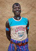 The football stars of tomorrow<br /> <br /> Thousands of Football shirts of Arsenal, Manchester, Chelsea, Milano, etc end up their carreer in... Ethiopia. Sold in the deep south, in the Omo Valley, those second hand clothes are bought by the local tribes. Most of them ignore the meaning of those shirts, and just buy them for the color, the logo, or the shape.<br /> No warrior will go out without his little pillow/seat.<br /> Some, like in Hamer tribe wear at the top of the head a clay helmet where they can put some ostrich feathers when they make a special action, like killing a wild animal, or...a man.<br /> Those tribes won&rsquo;t exist in few years as the ethiopian governement has launched a huge plan to develop the area.<br /> Soon, a highway coming from Mombassa - Nairobi will pass thru the villages to reach Addis Ababa.<br /> <br /> Photo shows: Bana tribe - Arsenal<br /> &copy;Eric Lafforgue/Exclusivepix Media
