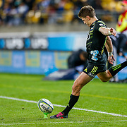 Beauden Barrett kicks a conversion during the Super rugby union game (Round 14) played between Hurricanes v Reds, on 18 May 2018, at Westpac Stadium, Wellington, New  Zealand.    Hurricanes won 38-34.