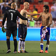 Neymar, Brazil, (centre) swaps shirts with Michael Bradley, USA, and shakes hands with USA keeper Tim Howard after  the USA V Brazil International friendly soccer match at FedEx Field, Washington DC, USA. 30th May 2012. Photo Tim Clayton