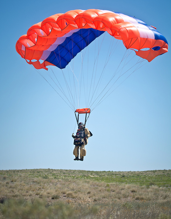 Jacob Blehm, a BLM smokejumper from the Great Basin, based out of Boise, Idaho, prepares to touch down near the Rio Puerco during a proficiency jump out of Double Eagle II Airport in Albuquerque, N.M., Tuesday, June 29, 2017.  Smokejumpers are the elite wildland firefighters who parachute into remote, inaccessible locations to put fires out, according to a news release from the U.S. Forest Service. About 20 smokejumpers are practicing while waiting to be called to any forest fires in the region.  There were eight smokejumpers who jumped out of a Twin Otter at about 3,000 ft. To see more photo from the jumps, go to ABQJournal.com. (Marla Brose/Albuquerque Journal)