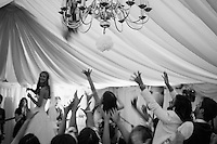 Oxfordshire wedding bouquet toss professionally captured by Steven O'Gorman - photographer