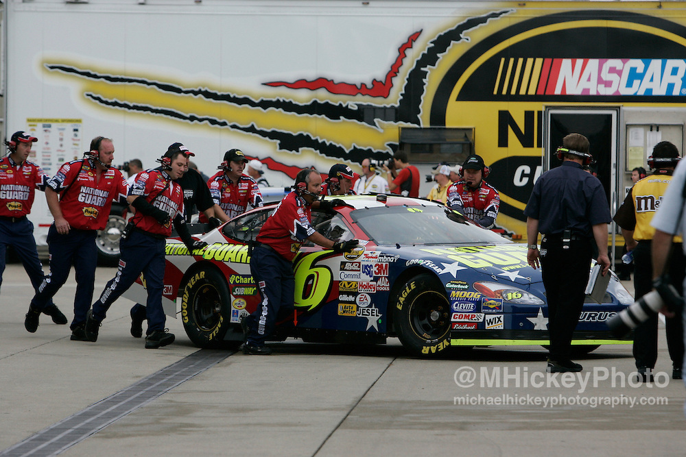 Greg Biffle's crew pushes his car into his garage during practice for the Allstate 400 at the Brickyard in Indianapolis, IN.