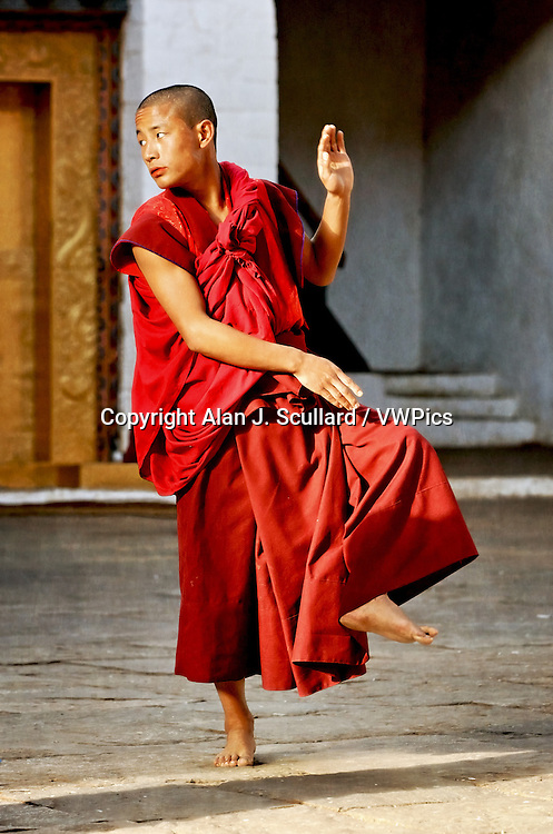 Bhutanese Buddhist monks rehearsing a religious dance in Punakha Dzong (temple) in Bhutan. Digitally Manipulated Image. Stylised by sharpening and enhancing color