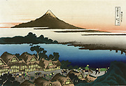 Dawn at Isawa in the Kai province: c1833.   From 'Thirty-six Views of Mount Fuji', c1831. One of 10 supplementary images. Katsushika Hokusai (1760-1849)  Japanese Ukiyo-e artist.   Buildings Thatch Road Transport Horse Pedestrian