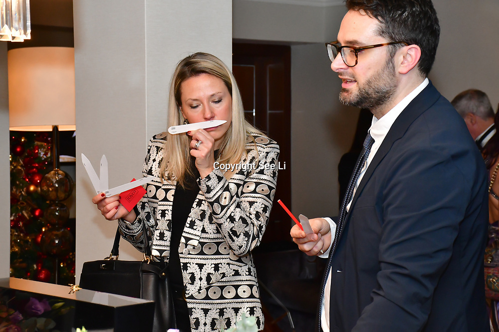 Guest smelling Jovoy perfumes at  Rochay High Society Soiree with Jovoy at Westbury Mayfair grafton suite on 21 November 2019, London, UK.