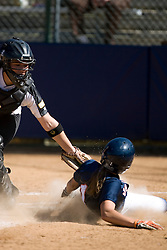 Virginia Cavaliers SS/2B Casey Steffan (1) slides into home plate against Towson.  The Virginia Cavaliers Softball team faced the Towson University Tigers on April 3, 2007 at The Park in Charlottesville, VA.