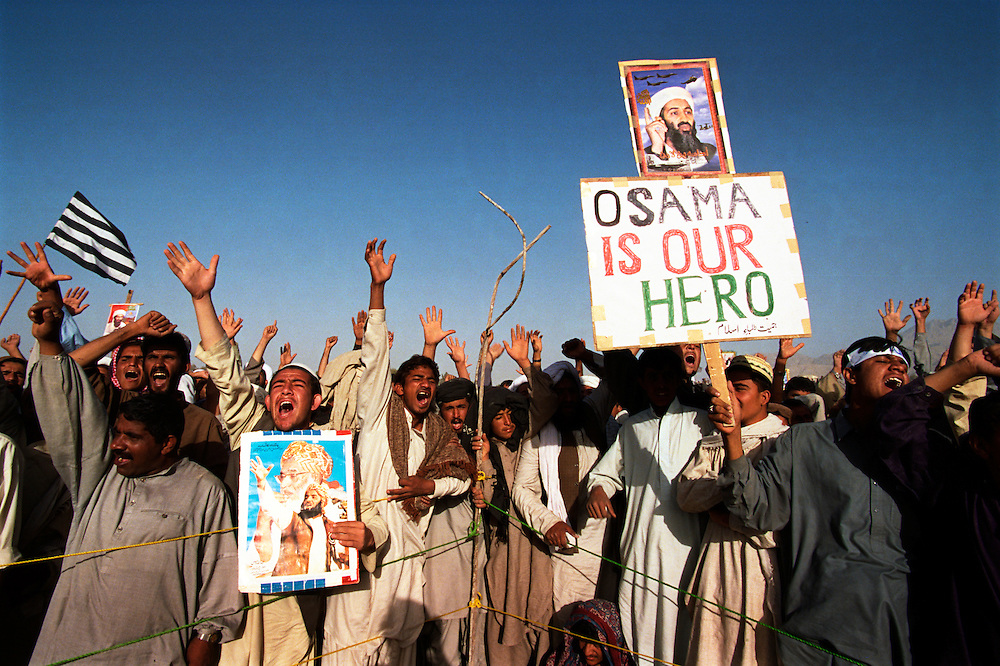 Supporters of the Taliban and Osama Bin Laden during a rally denouncing US military strikes in Afghanistan held on a national day of strikes that was organized by a coalition of Islamist political parties. The demonstrators denounced the Pakistani government's support of the US and called for a holy Jihad against the West..Quetta, Pakistan. 15 October 2001.Photo © J.B. Russell