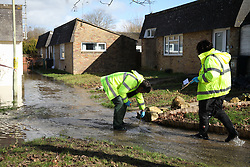 © Licensed to London News Pictures. 22/02/2014. Basingstoke, Hampshire. Authorities checking water levels of flowing river through a path near Grampian Way in the Buckskin area of Basingstoke, Hampshire. Groundwater levels are continuing to rise in the area, forcing 69 homes to be evacuated in the Buckskin Area of the commuter town. Photo credit : Rob Arnold/LNP