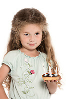 caucasian little girl portrait holding birthday cake isolated studio on white background