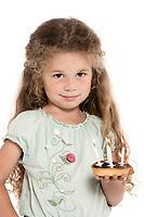 caucasian little girl portrait holding birthday cake isolated studio on white background