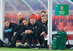 NANNING, CHINA - Thursday, March 22, 2018: Wales' new manager Ryan Giggs on the bench with his staff during the opening match of the 2018 Gree China Cup International Football Championship between China and Wales at the Guangxi Sports Centre. Medical Officer Doctor Jon Houghton, physiotherapist Sean Connelly, assistant coach Albert Stuivenberg, assistant coach Osian Roberts. (Pic by David Rawcliffe/Propaganda)