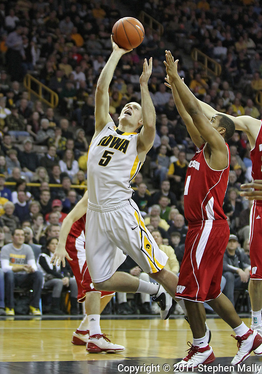 February 09 2011: Iowa Hawkeyes guard Matt Gatens (5) puts up a shot over Wisconsin Badgers guard Jordan Taylor (11) during the second half of an NCAA college basketball game at Carver-Hawkeye Arena in Iowa City, Iowa on February 9, 2011. Wisconsin defeated Iowa 62-59.