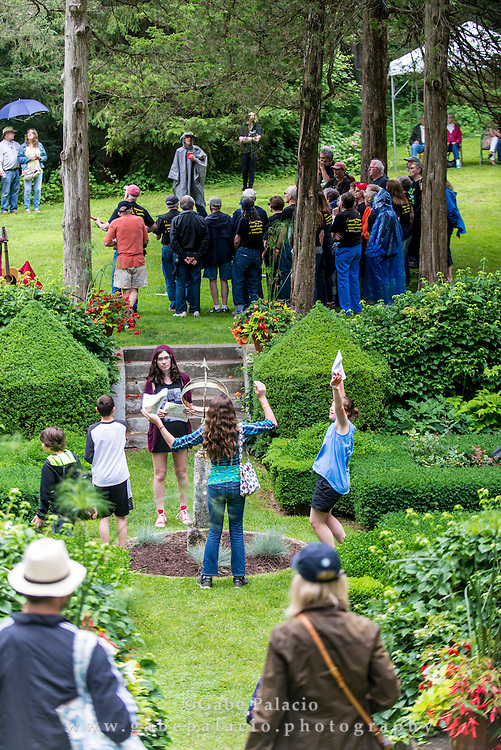 The Walkabout Clearwater Chorus performs in the Sunken Garden during the American Roots Music Festival at Caramoor in Katonah New York on June 27, 2015. <br /> (photo by Gabe Palacio).