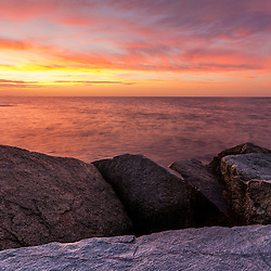 Sunrise from the breakwater at Rye Harbor State Park in Rye, New Hampshire.