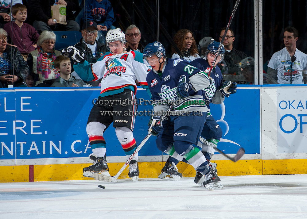 KELOWNA, CANADA - APRIL 5: Tyson Baillie #24 of the Kelowna Rockets is checked into the boards as Ethan Bear #25 of the Seattle Thunderbirds skates with the puck on April 5, 2014 during Game 2 of the second round of WHL Playoffs at Prospera Place in Kelowna, British Columbia, Canada.   (Photo by Marissa Baecker/Getty Images)  *** Local Caption *** Tyson Baillie; Ethan Bear;