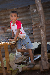 Central America, Nicaragua, Granada, boy by shack