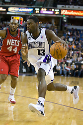 November 27, 2009; Sacramento, CA, USA;  Sacramento Kings guard Tyreke Evans (13) dribbles past New Jersey Nets forward Trenton Hassell (44) during the third quarter at the ARCO Arena. Sacramento defeated New Jersey 109-96.