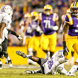 Oct 26, 2013; Baton Rouge, LA, USA; LSU Tigers wide receiver Odell Beckham (3) runs after a catch for a touchdown against the Furman Paladins during the second half of a game at Tiger Stadium. LSU defeated Furman 48-16. Mandatory Credit: Derick E. Hingle-USA TODAY Sports