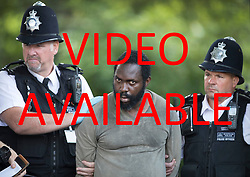 VIDEO AVAILABLE : http://tinyurl.com/ycd2jz2t  © Licensed to London News Pictures. 22/06/2017. London, UK. Police hold a man who earlier was tasered near an entrance to Parliament. Photo credit: Peter Macdiarmid/LNP
