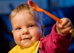 13.03.2011, Graz, AUT, Feature, im Bild ein Baby mit blonden Haaren hat sich beim Essen mit dem Loeffel den Brei auf die Nase gekleckert, EXPA Pictures © 2012, PhotoCredit: EXPA/ Erwin Scheriau