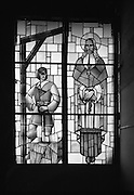 Stained Glass window Of St Oliver Plunkett.  (J87)..1975..07.11.1975..11.07.1975..7th November 1975..A stained glass window depicting the martyrdom of St Oliver Plunket was unveiled today at Irish Stained Glass Co.,Hanover Quay, Dublin 2..St Oliver Plunket was tried in London on the basis of a fabricated plot to bring French troops into Ireland to help oust the English. Although there was no truth in the accusations he was condemmed and sentenced to be executed. He was hung,drawn and quartered at Tyburn Hill,London England. He was beatified in the 1920s and was Canonised in 1975 the first Irish saint for 700 years...The mummified head of St Oliver is on display in the shrine at St Peters Catholic Church, Drogheda, Co Louth..Oliver Plunkett 1629 - 1681.