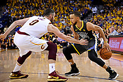 June 3, 2018; Oakland, CA, USA; Golden State Warriors guard Stephen Curry (30) handles the ball against Cleveland Cavaliers center Kevin Love (0) during the fourth quarter in game two of the 2018 NBA Finals at Oracle Arena.
