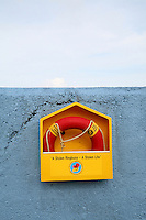 Lifebuoy on a blue wall in Dun Laoghaire Dublin Ireland