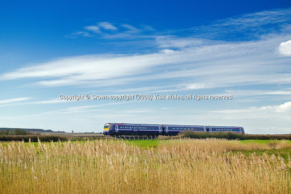 Train near Kidwelly<br /> Arriva Trains Wales<br /> Carmarthenshire<br /> West Wales<br /> Rail<br /> Transport