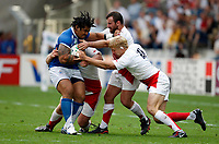 Photo: Richard Lane/Sportsbeat Images.<br />England v Samoa. Pool A, IRB Rugby World Cup, RWC 2007. 22/09/2007. <br />Samoa's Alfie Vaeluaga is tackled by England's defence.