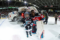 KELOWNA, CANADA - DECEMBER 3: Michael Herringer #30 of the Kelowna Rockets stands on the ice with a young fan after the annual teddy bear toss on December 3, 2016 at Prospera Place in Kelowna, British Columbia, Canada.  (Photo by Marissa Baecker/Shoot the Breeze)  *** Local Caption ***