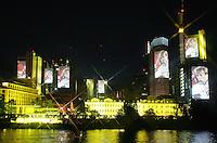Feature Skyline Frankfurt a. M.          Zur Feier der Fussball-Weltmeisterschaft werden in Frankfurt am Main nachts ueberdimensionale Fotos der vergangenen Fussball-Weltmeisterschaften auf die Skyline der Stadt projeziert, untermalt mit Musik und Lichteffekten. Hier wird ein Foto von Juergen KLINSMANN, Trainer der deutschen Nationalmannschaft auf die Skylinee projeziert.