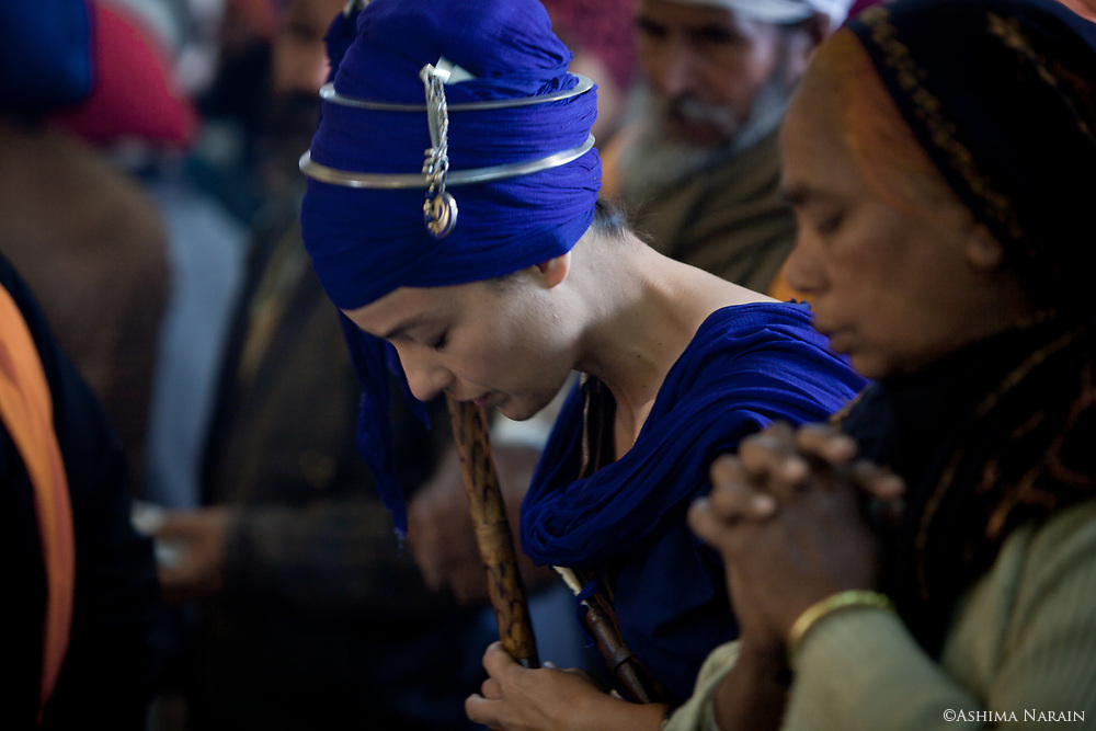In Sikhism, women & men are equals, but the path of a Nihang is hard for women as society is not yet as progressive as the ideology. However, in 2012, a Texan, Harsangat Raj Kaur, of Persian and Swedish origin, attended her first Hola Mohalla and was the 1st girl to race a horse. She hoped to ride in the procession this year with the Biddichand Dal, but due to concerns for her safety, she was not given a horse but had the honour of leading the procession from atop an elephant.