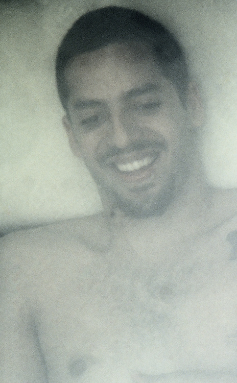 Close-up of Magician David Blaine smiling at the crowd during his buried alive event in New York City, April 1999; Blaine was enclosed in a plastic box beneath a transparent tank filled with three tons of water from April 5, 1999 to April 12, 1999.