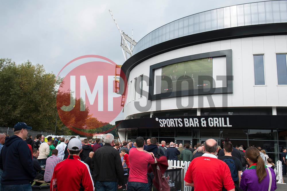Fans look on at the big screen outside the Sports Bar and Grill - Mandatory byline: Dougie Allward/JMP - 07966 386802 - 03/10/2015 - FOOTBALL - Ashton Gate - Bristol, England - Bristol City v MK Dons - Sky Bet Championship