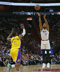 March 1, 2018 - Miami, FL, USA - The Miami Heat's Rodney McGruder hits a 3-pointer against the Los Angeles Lakers' Kentavious Caldwell-Pope during the first quarter at the AmericanAirlines Arena in Miami on Thursday, March 1, 2018. The Lakers won, 131-113. (Credit Image: © David Santiago/TNS via ZUMA Wire)