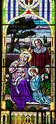 Stained glass image from St. Joseph Church in Kellnersville, Wis., depicts a youthful Mary with her parents, St. Anne and St. Joachim. (Sam Lucero photo)