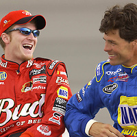 Teammates Dale Earnhardt, Jr. and Michael Waltrip share a laugh before they go out to qualify for the running of the Auto Clulb 500 NASCAR Winston Cup race at the California Speedway in Fontana, California.