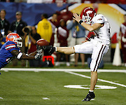 Arkansas punter Jacob Skinner has a punt blocked in the 2nd quarter by Florida WR Jarred Fayson during the SEC Championship game between the Arkansas Razorbacks and the Florida Gators at the Georgia Dome in Atlanta, GA on December 2, 2006.<br />