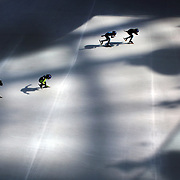 Patterns of light and shade cover the ice at Lotte World Indoor Ice Rink, Seoul, Korea, as very young aspiring speed skaters train under the watchful eye of their coaches as they hurtle around the rink at incredible speeds. Speed Skating has huge popularity in South Korea as the national team dominate the sport at International level. Seoul, South Korea. 21st March 2012. Photo Tim Clayton