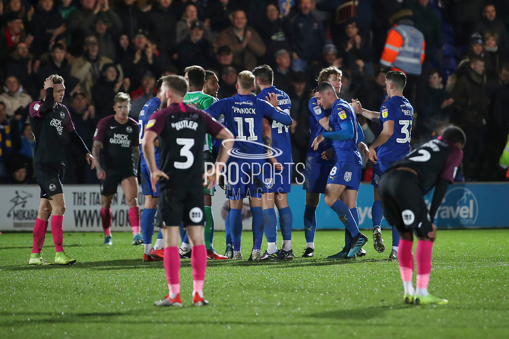 AFC Wimbledon players celebrating win during the EFL Sky Bet League 1 match between AFC Wimbledon and Peterborough United at the Cherry Red Records Stadium, Kingston, England on 18 January 2020.